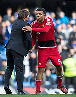 Troy Deeney of Watford with Chelsea manager Antonio Conte at full time during the Premier League match between Chelsea and Watford at Stamford Bridge, London, England on 21 October 2017. Photo by Andy Rowland.