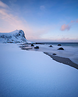 Sea meets snow at Myrland beach in Winter, Flakstadøy, Lofoten Islands, Norway