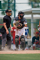 GCL Pirates catcher Daniel Angulo (27) checks the runner during a Gulf Coast League game against the GCL Red Sox on August 1, 2019 at Pirate City in Bradenton, Florida.  GCL Red Sox defeated the GCL Pirates 11-3.  (Mike Janes/Four Seam Images)