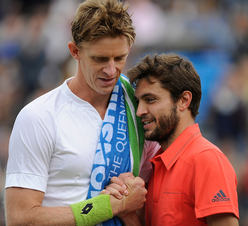 Kevin Anderson (RSA) congratulated by Gilles Simon (FRA) after his victory in their Men&rsquo;s Singles Semi Final match - Kevin Anderson (RSA def Gilles Simon (FRA) 6-3, 6-7, 6-3<br /> <br /> <br /> Photographer Ashley Western/CameraSport<br /> <br /> Tennis - ATP 500 World Tour - AEGON Championships- Day 6 - Saturday 20th June 2015 - Queen's Club - London <br /> <br /> &copy; CameraSport - 43 Linden Ave. Countesthorpe. Leicester. England. LE8 5PG - Tel: +44 (0) 116 277 4147 - admin@camerasport.com - www.camerasport.com