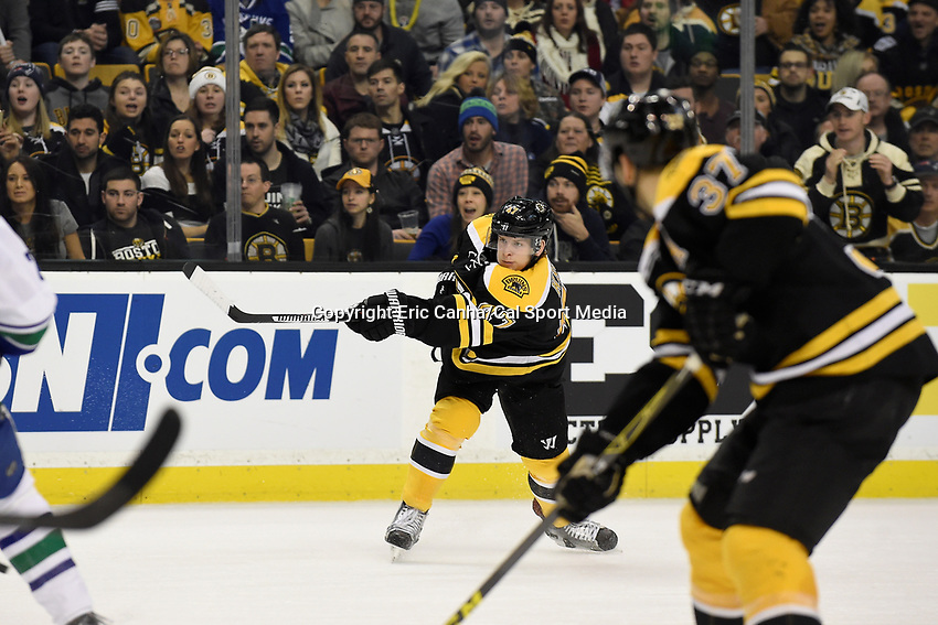 Thursday, January 21, 2016: Boston Bruins defenseman Torey Krug (47) takes a shot during the National Hockey League game between the Vancouver Canucks and the Boston Bruins, held at TD Garden, in Boston, Massachusetts. Vancouver beats Boston 4-2. Eric Canha/CSM