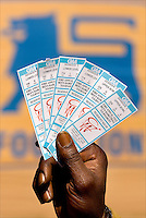 A man holds up a group of tickets for the CIAA during the CIAA Tournament  in Charlotte, NC.
