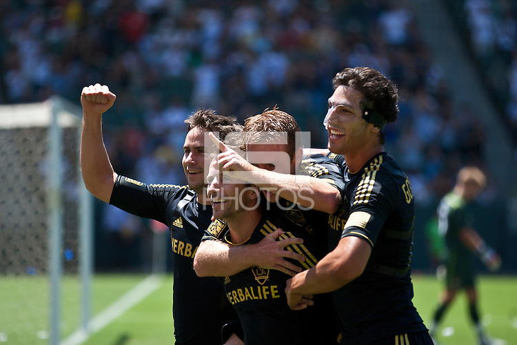 CARSON, CA – July 24, 2011: LA Galaxy players Todd Dunivant (2), Mike Magee (18), Chris Birchall (8) and Omar Gonzalez (4) celebrate Magee's goal during the match between LA Galaxy and Manchester City FC at the Home Depot Center in Carson, California. Final score Manchester City FC 1 and LA Galaxy 1. Manchester City wins shoot out 7, LA Galaxy 6.