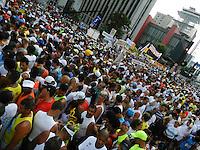 ATENÇÃO EDITOR: FOTO EMBARGADA PARA VEÍCULOS INTERNACIONAIS. - SÃO PAULO - SP -  31 DE DEZEMBRO 2012. CORRIDA DE SAO SILVESTRE, 88ª Corrida Internacional de São Silvestre na manhã desta segunda-feira (31), na Avenida Paulista em São Paulo (SP). A mais tradicional corrida de Rua do Brasil permitindo aos corredores passarem diante dos principais pontos turísticos e marcos históricos da cidade de São Paulo. FOTO: MAURICIO CAMARGO / BRAZIL PHOTO PRESS.