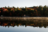 Mississauga Lake reflection with mist, fall colors and lakefront homes in the distance.