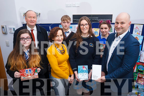 The runners up and winner of the Kerry ETB Christmas card competition, l to r: Emilia Girasole (Coaiste na Riochta), Cllr: Jim Finuchan, Conor Hope (Colaiste na Riochta), Ann O'Dwyer (Dir of Schools Kerry ETB) presenting to the winner Caiomhe Curran (Colaiste na Sceilge), Agna Arl Auskaite (Castleisland Community College) and Brendan Culloty (Hugh Culloty Experts Tralee).