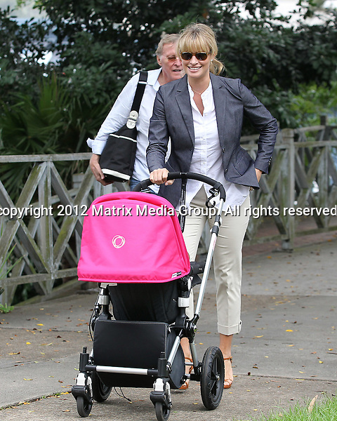 27/1/2012. Sydney, Australia...NON EXCLUSIVE..Kristy Hinze and husband Jim Clark take Dylan out for lunch at Pier Rose Bay. Pictured leaving the restaurant.27/1/2012. Sydney, Australia...NON EXCLUSIVE..Kristy Hinze and husband Jim Clark take Dylan out for lunch at Pier Rose Bay. Pictured leaving the restaurant...*No internet without clearance*.MUST CALL PRIOR TO USE ..02 9211-1088.Matrix Media Group.Note: All editorial images subject to the following: For editorial use only. Additional clearance required for commercial, wireless, internet or promotional use.Images may not be altered or modified. Matrix Media Group makes no representations or warranties regarding names, trademarks or logos appearing in the images.