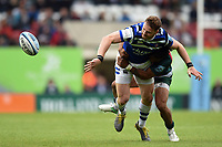 Max Wright of Bath Rugby offloads the ball after being tackled by Kyle Eastmond of Leicester Tigers. Gallagher Premiership match, between Leicester Tigers and Bath Rugby on May 18, 2019 at Welford Road in Leicester, England. Photo by: Patrick Khachfe / Onside Images