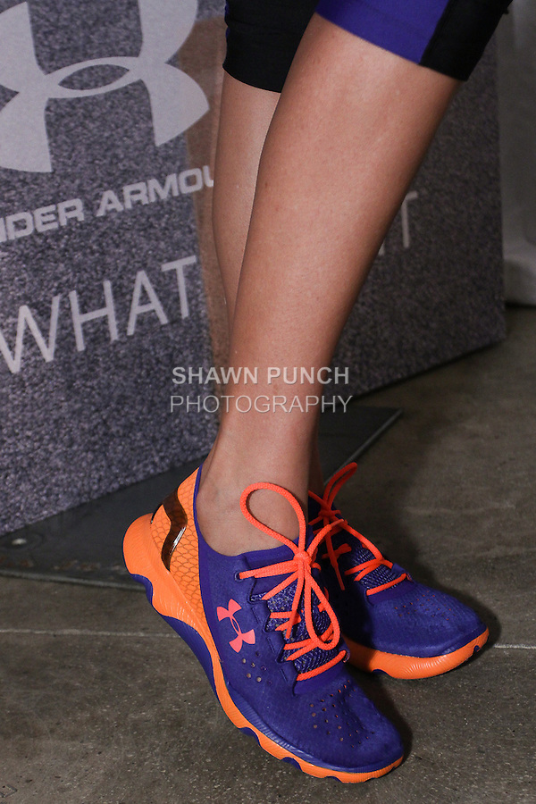 """Model poses in sneakers during the Under Armour, """"I will what I want"""" global women's campaign launch, on July 31, 2014, in New York City."""