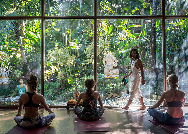 6 DECEMBER, 2019 BALI, INDONESIA:  From left to right Lea Lock (,in reflection23), Chanel Gricius (23), Zoe Giliomee (24) and Christel Smook (23), loosen up for a class at The Yoga Barn in Ubud, Bali. There has been a levelling out of Australian tourist numbers to Bali in recent times and tastes are changing regarding what people want from their holiday. Millennials are being targeted by tourism authorities and they want to give them more boutique experiences than just beach and beer. Picture by Graham Crouch/The Australian