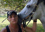 WEST HILLS,NY-MONDAY, SEPTEMBER 3, 2007:  Gregg Lopez of Huntington with &quot;Titania&quot; a Thoroughbred horse with whom he has bonded in Equine Therapy at the Stanhope Stables in West Hills on Monday September 3, 2007. Lopez suffers from a variety of ailments both physical and mental from the months he worked in recovery efforts at the World Trade Center Ground Zero.<br /> <br /> Newsday / Jim Peppler