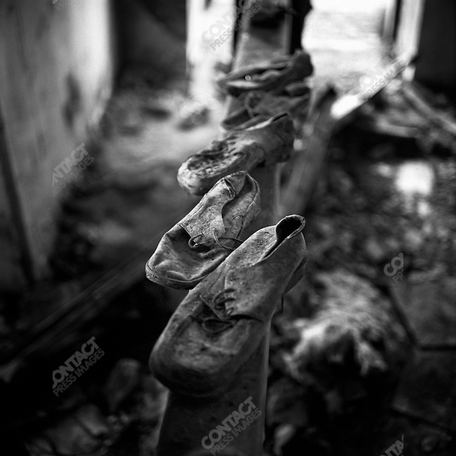 The shoes of victims of the tragedy at school #1 in Beslan lay on the gymnastics bar next to the sports hall were the hostages were held and where most of them died when the bombs went off on September 3, 2004. Beslan, North Ossetia, September - October, 2004
