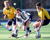 Jaime Gonzalez-Laguillo (C) sets up an attack for Hampstead during the England Hockey League Mens Cup Quarter Final game between Hampstead & Westminster and Old Loughtonians at Paddington Rec, Maida Vale on Sun Mar 7, 2010