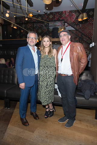 TORONTO, CAN - SEPTEMBER 7: Charlie Stratton, Elizabeth Olsen, William Horberg at the Therese after party during the  2013 Toronto International Film Festival at Patria in Toronto, Canada. Credit: Lu Chau/Photagonist .ca /MediaPunch Inc.MediaPunch Inc.
