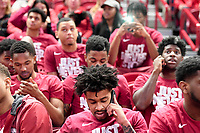 NWA Democrat-Gazette/CHARLIE KAIJO Arkansas Razorbacks players make phone calls after the NCAA selection show announcement, Sunday, March 11, 2018 at Bud Walton Arena in Fayetteville. The Razorbacks will play Butler in Detroit on Friday