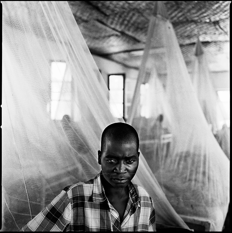 Kuito, Angola, May, 22, 2006.Aurelio, 21, suffers from Tuberculosis and is a patient in Bié Province Hospital. TB is endemic in the region, fueled by poverty, malnutrition, inadequate hygiene and the rapid spreading of HIV/AIDS since the end of the civil war in 2002.