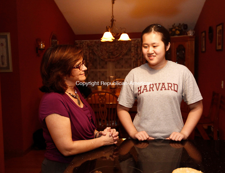 Winsted, CT- 02 October 2013-100213CM15-   Chinese exchange student, Vivian Qian, right, chats with her host mom, Danise Hall in Winsted Wednesday night.  Christopher Massa Republican-American