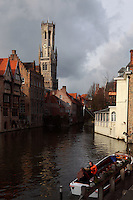 "BRUGES, BELGIUM - FEBRUARY 08 : A general view of the ""Befroi"" (Belfort) from Rozenhoedkaai on February 08, 2009 in Bruges, West Flanders, Belgium. The belfry is 83m tall, was built in 1240 and is listed by the UNESCO as World Heritage Site. A wooden small embarcation with tourists on board, is waiting for the next city guide departure. (Photo by Manuel Cohen)"
