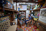 """Larren Jo """"LJ"""" Bacilio, a teacher in the Alternative Learning System of the Kapatiran-Kaunlaran Foundation (KKFI), talks with two of his students at their home in the Tondo neighborhood of Manila, Philippines. <br /> <br /> KKFI is supported by United Methodist Women."""