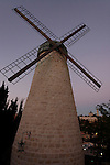The windmill at Yemin Moshe, the first Jewish residence built outside the Old City walls is named after Sir Moses Montefiore who established the neighborhood, Mount Zion is in the background<br />