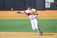 Cincinnati Bearcats shortstop Ian Happ (5) makes a throw to first base against the Radford Highlanders at Wake Forest Baseball Park on February 22, 2014 in Winston-Salem, North Carolina.  The Highlanders defeated the Bearcats 6-5.  (Brian Westerholt/Four Seam Images)