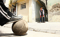 19.04.12 Boys play football in the backstreets of Armanaz, Northern Syria.