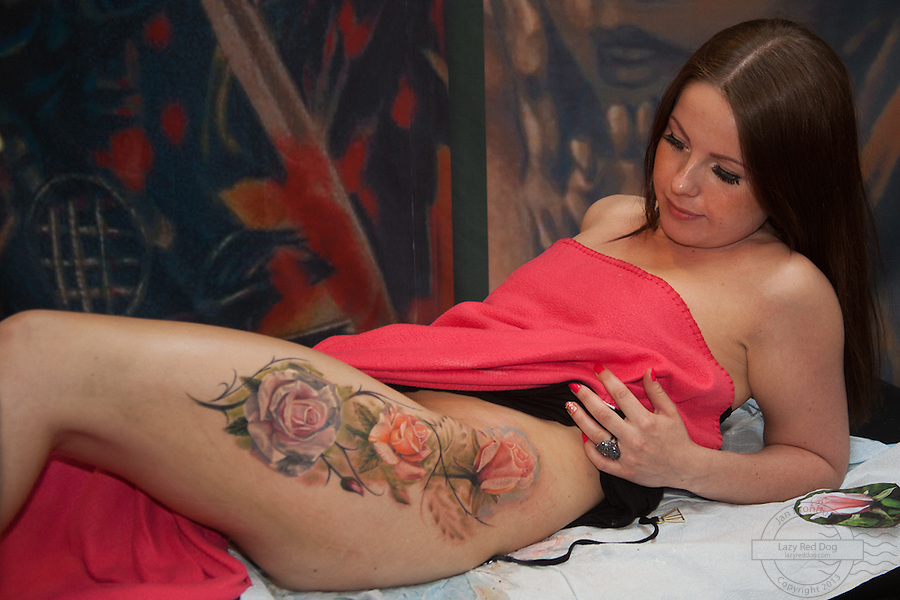 Tattoo. Snapshots from Copenhagen Ink Festival 2013. Roses on hip and leg done by Mornel from Artistico
