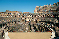 The central arena of the Roman Colosseum is a 287 long and 180 ft wide oval, surrounded by a 15 ft high wall above which rose tiers of seating. A section of the arena floor, originally made with wooden planks covered with yellow sand taken from the hill of Monte Mario, was reconstructed a decade ago to give some sense of how the stadium looked.