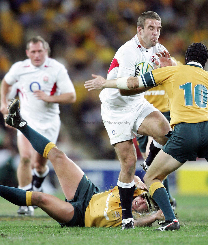 Photo: Adam Head.England v Australia Rugby Test in Brisbane. 26/06/2004..Joe Worsley tackled by Stephen Larkham..