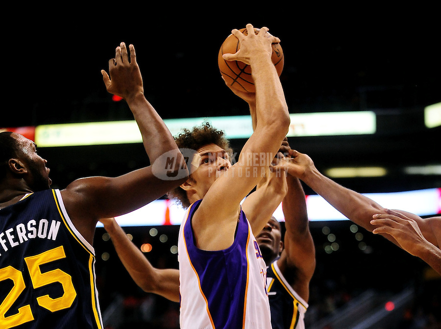 Oct. 12, 2010; Phoenix, AZ, USA; Phoenix Suns center (15) Robin Lopez drives to the basket against the Utah Jazz during a preseason game at the US Airways Center. Mandatory Credit: Mark J. Rebilas-