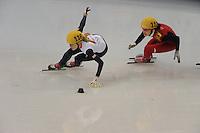OLYMPICS: SOCHI: Iceberg Skating Palace, 13-02-2014, Shorttrack, 500m Relay Ladies, Semifinals, Elise Christie (#116 | GBR), Qiuhong (#112 | CHN), ©photo Martin de Jong