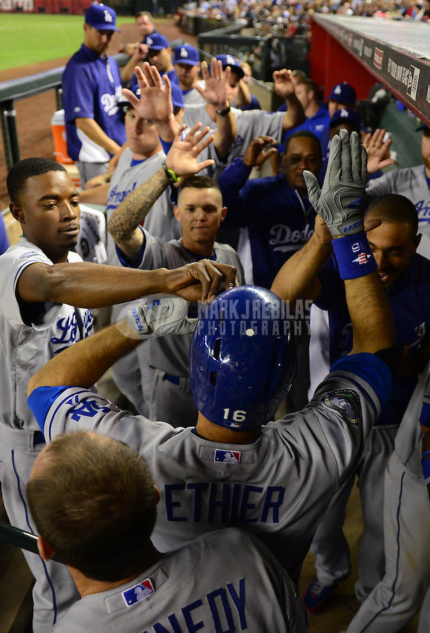 May 21, 2012; Phoenix, AZ, USA; Los Angeles Dodgers outfielder Andre Ethier (center) is congratulated by teammates in the dugout after hitting a solo home run in the seventh inning against the Los Angeles Dodgers at Chase Field.  Mandatory Credit: Mark J. Rebilas-