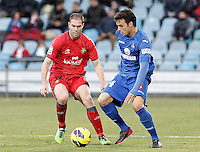 Getafe's Pedro Leon (r) and Osasuna's Nano Macedo during La Liga match.December 15,2012. (ALTERPHOTOS/Acero) /NortePhoto