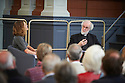 Rowan Williams, Archbishop of Canterbury  with Eliza Griswold ,journalist, at The Sheldonian Theatre  at The  Sunday Times Oxford Literary Festival  . Credit Geraint Lewis