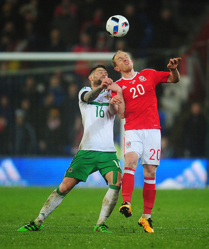 Wales' Jonathan Williams vies for possession with Northern Ireland&rsquo;s Oliver Norwood<br /> <br /> Photographer Kevin Barnes/CameraSport<br /> <br /> Football - International Friendly - Wales v Northern Ireland - Thursday 24th March 2016  - Cardiff City Stadium - Cardiff<br /> <br /> &copy; CameraSport - 43 Linden Ave. Countesthorpe. Leicester. England. LE8 5PG - Tel: +44 (0) 116 277 4147 - admin@camerasport.com - www.camerasport.com