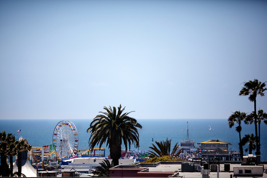 CREDIT: Daryl Peveto/LUCEO for The Wall Street Journal.SLUG: Macerich .ASSIGNMENT ID: 4429..Santa Monica, California, June 24, 2010 - A view of the Santa Monica Pier from the rooftop patio of the Santa Monica Place mall, which is receiving a $265 million makeover. Located at the end of Santa Monica's bustling Third Street Promenade and just two blocks from the Santa Monica Pier, the open-air mall is in the heart of Santa Monica's shopping district. The 2.5-year effort called for closing the dour, 28-year-old mall in early 2008, stripping it to its steel frame and remaking it as a modern shopping venue with several cutting-edge features. The three-level complex has no roof, reflecting the trend of recent years toward building open-air malls. Its first two levels are populated with a mix of fashion and luxury retailers including Tiffany & Co. and Juicy Couture sprinkled among big-box stores such as Nike and furniture-and-décor seller CB2. The mall will be anchored by Nordstrom and Bloomingdales. Retailers on its ground floor surround an expansive plaza. Santa Monica Place's bigger departure from the typical mall format is its third floor, which will be occupied entirely by restaurants. The collection is anchored by six high-end, chef-helmed eateries including the Ozumo sushi restaurant. Joining them are eight casual eateries and a gourmet market where shoppers can find groceries and meals to go. One of the restaurants' main selling points will be that their patio dining areas offer views of the Pacific...
