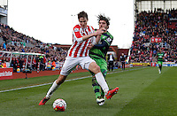 Stoke City's Philipp Wollscheid battles with Swansea City's Alberto Paloschi during the Barclays Premier League match between Stoke City and Swansea City played at Britannia Stadium, Stoke on April 2nd 2016