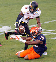 Maryland Terrapins defensive back Isaac Goins (17) breaks up the pass intended for Virginia Cavaliers wide receiver E.J. Scott (19) in the final seconds of the game Saturday at Scott Stadium in Charlottesville, VA. Maryland defeated Virginia 27-20.