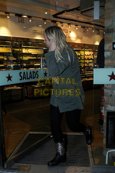 Jennifer Ellison .Spotted in central London, England..28th January, 2013.full length green jacket pret a manger takeaway food black leggings boots studs studded side profile hand arm door.CAP/IA.©Ian Allis/Capital Pictures.