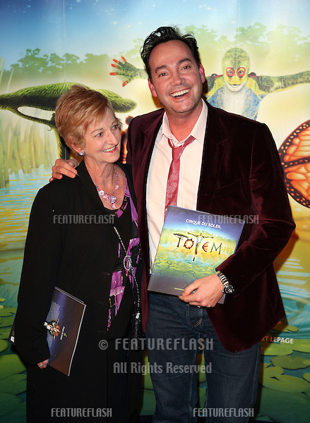 Craig Revel Horwood and mother arriving for the gala premiere of Cirque Du Soleil's 'Totem' , at the Royal Albert Hall, London. 05/01/2011. Picture by: Alexandra Glen / Featureflash
