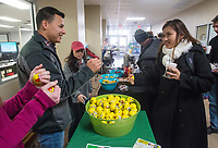 NWA Democrat-Gazette/BEN GOFF @NWABENGOFF<br /> Luis Rodriguez, a student government representative from Fayetteville, offers a stress ball to student Alice Huynah of Fayetteville Wednesday, Dec. 5, 2018, during the Student Ambassadors and Government Association's finals stress relief party in Burns Hall at Northwest Arkansas Community College in Bentonville. Representatives from SAGA were offering snacks, coffee, hot chocolate, stress balls, and chair massages Tuesday and Wednesday as students prepare for their final exams next week.