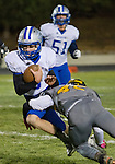 McQueen quarterback #3 Zach Ball is hit by Galena's defender Mateo Lemus during their Northern Division I playoff football game played on Friday night, November 6, 2015 at Galena High School in Reno, Nevada.