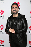 LOS ANGELES - JAN 17:  Enrique Santos at the 2020 iHeartRadio Podcast Awards at the iHeart Theater on January 17, 2020 in Burbank, CA