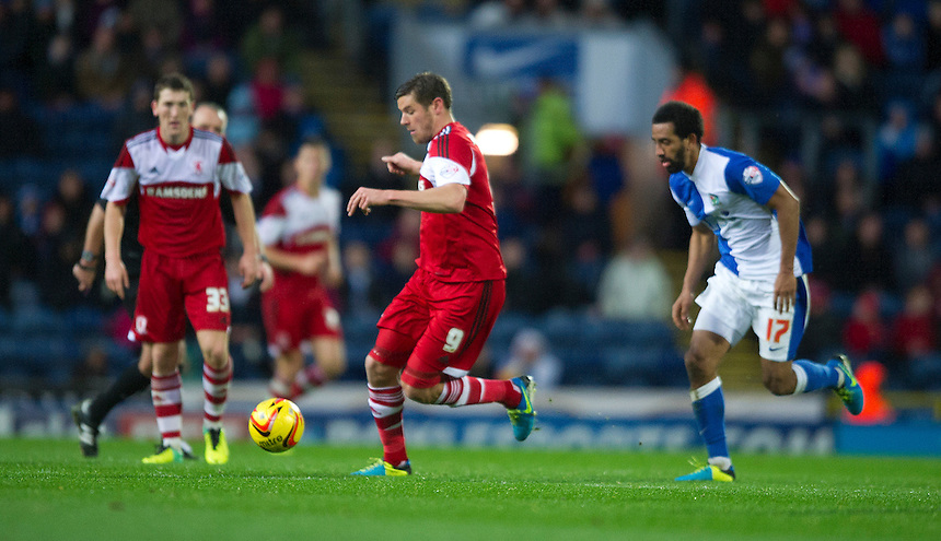 Middlesbrough's Lucas Jutkiewicz shields the ball from Blackburn Rovers' Lee Williamson<br /> <br /> Photo by Stephen White/CameraSport<br /> <br /> Football - The Football League Sky Bet Championship -  Blackburn Rovers v Middlesbrough - Saturday 2nd November 2013 - Ewood Park - Blackburn<br /> <br /> &copy; CameraSport - 43 Linden Ave. Countesthorpe. Leicester. England. LE8 5PG - Tel: +44 (0) 116 277 4147 - admin@camerasport.com - www.camerasport.com