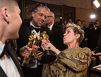 Paul Lambert (left), Frances McDormand, and J. Miles Dale at the Governors Ball after the live ABC Telecast of The 90th Oscars&reg; at the Dolby&reg; Theatre in Hollywood, CA on Sunday, March 4, 2018.<br /> *Editorial Use Only*<br /> CAP/PLF/AMPAS<br /> Supplied by Capital Pictures