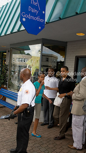 Alexandria, VA - June 20, 2009 -- United States President Barack Obama and eldest daughter Malia exit the Dairy Godmother frozen custard shop in the Del Ray section of Alexandria, Virginia, Saturday, June 20, 2009..Credit: John Harrington - Pool via CNP
