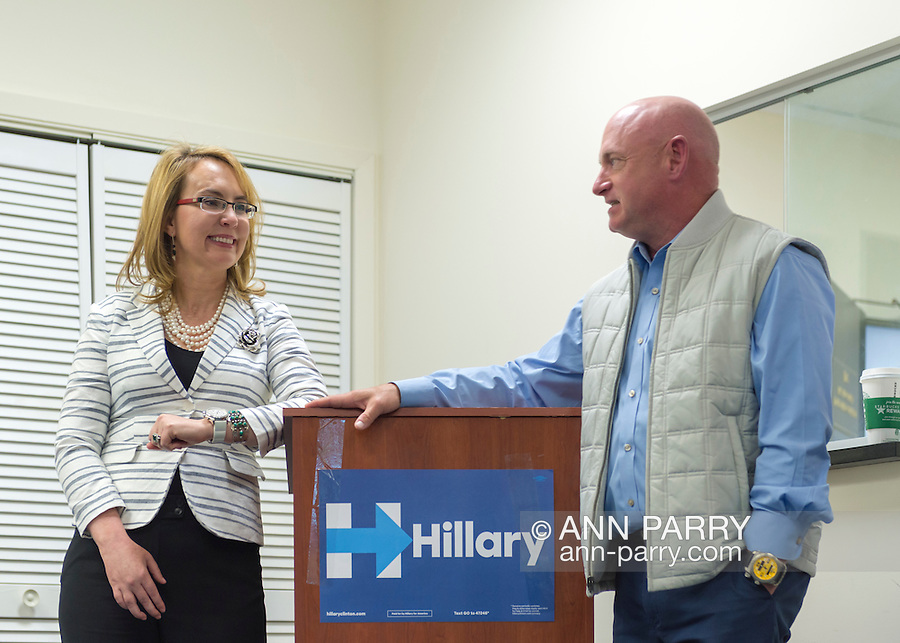 Garden City, New York, USA. April 17, 2016. GABBY GIFFORDS, former United States Congresswoman, and her husband MARK KELLY, former NASA astronaut, look at each other as they speak about the importance of GOTV, Getting Out The Vote for Hillary Clinton - including because of Clinton's strong position on stricter gun control legislation - at the Canvass Kickoff at the Nassau County Democratic Office in Garden City. After Kelly then Giffords spoke, they posed for photos with volunteers who attended the campaign Official Event. Giffords survived an assassination attempt near Tuscon, Arizona, during her first 'Congress on Your Corner' event in January 2011. Kelly commanded the final flight of the Space Shuttle Endeavor in May 2011.