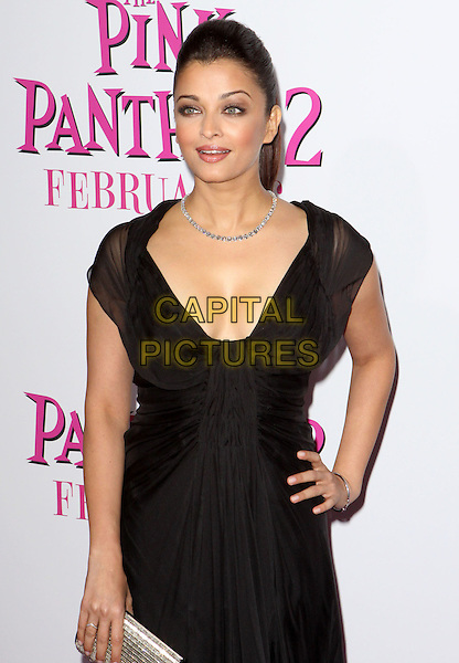 "AISHWARYA RAI BACHCHAN.""The Pink Panther 2"" World Premiere held at the Ziegfeld Theater, New York, NY, USA..February 3rd, 2009.half length necklace cleavage black sheer dress low cut neckline silver clutch bag hand on hip.CAP/ADM/PZ.©Paul Zimmerman/AdMedia/Capital Pictures."