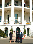 Washington, D.C. - November 2, 2005 -- United States President George W. Bush and first lady Laura Bush welcome Charles, the Prince of Wales and Camilla, the Duchess of Cornwall to the White House for a luncheon in Washington, D.C. on November 2, 2005. From left to right: Camilla, Duchess of Cornwall; first lady Laura Bush, Charles, Prince of Wales; and President Bush..Credit: Ron Sachs / CNP.(Restriction: No New York Metro or other Newspapers within a 75 mile radius of New York City)