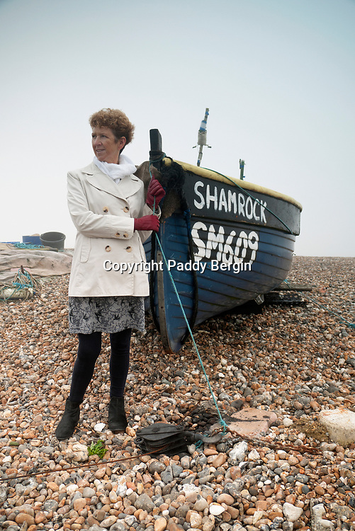 Carol on Lancing Beach with the Shamrock Fishing Boat.<br /> <br /> Stock Photo by Paddy Bergin